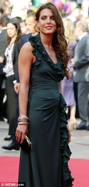 Royal touch: The stunning brunette was seen on the red carpet at Cannes Film Festival in May