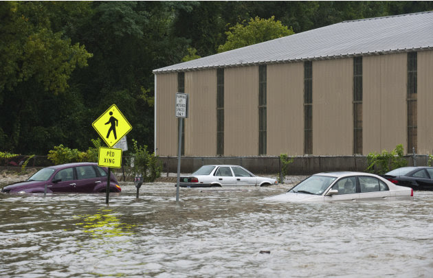 Cars in the parking lot at the bottom of Canal St. are submerged nearly to their windows by the flooding Whetstone Brook in Brattleboro, Vt. on Sunday, Aug. 28, 2011. The remnants of Hurricane Irene d