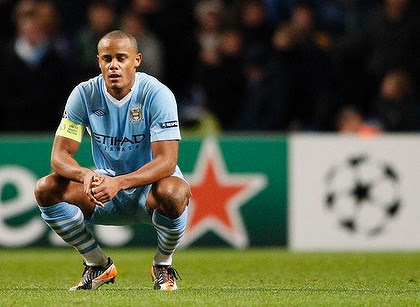 Manchester City's Vincent Kompany reacts after being knocked out of the Champions League.