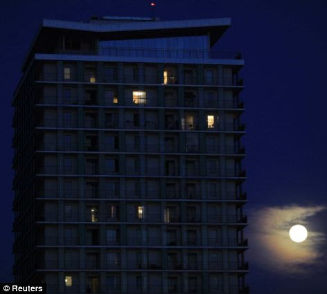 Towering: This apartment block in Bucharest proved a great place to view the supermoon