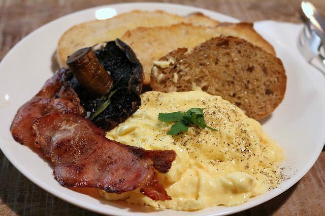 Breakfast: scrambled eggs with bacon and portobello mushroom