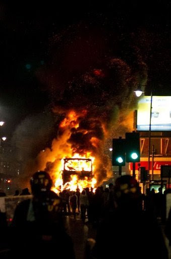 A double decker bus burns on a main road in Tottenham