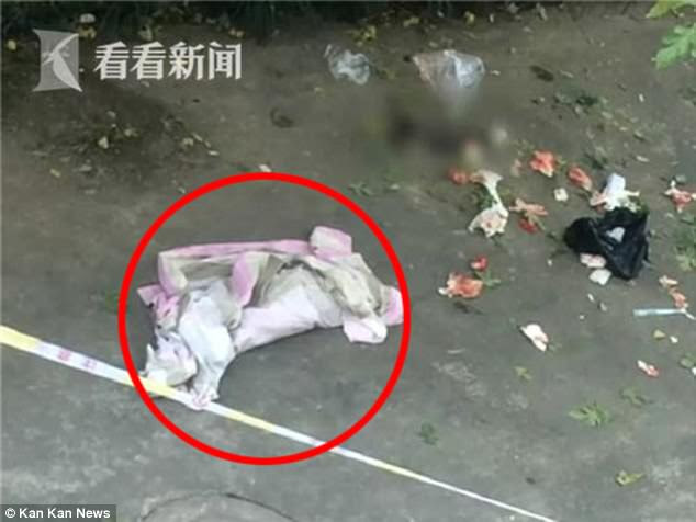 A newborn was  thrown out of a student dormitory in China and found dead in the alley