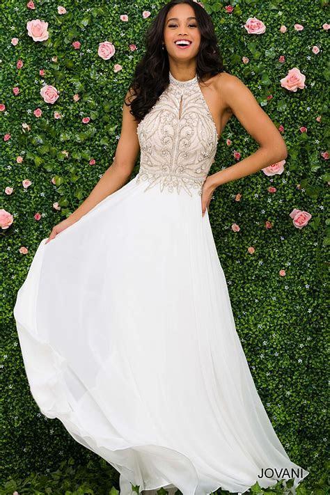 Ivory long flowy sleeveless chiffon halter neck prom dress.