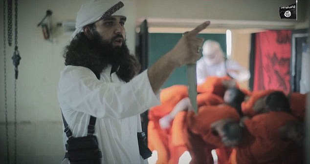 ISIS has marked Eid by hanging dozens of prisoners upside down from meat hooks and 'butchering them like sheep' in a gruesome new execution video. An executioner can be seen brandishing a large knife