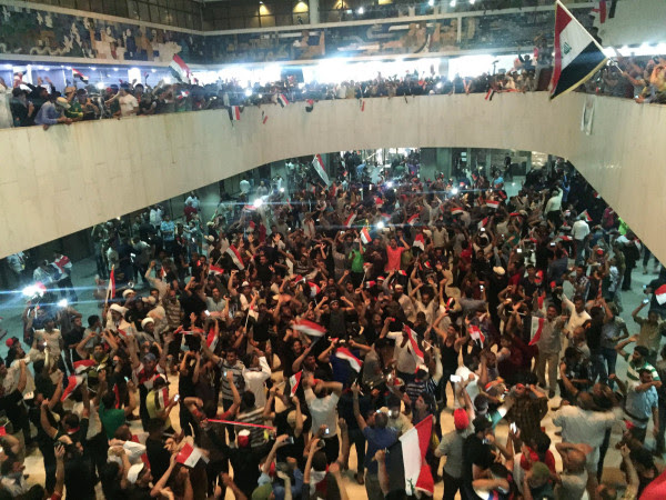 Image: Followers of Iraq's Shi'ite cleric Moqtada al-Sadr are seen in the parliament building as they storm Baghdad's Green Zone in Iraq