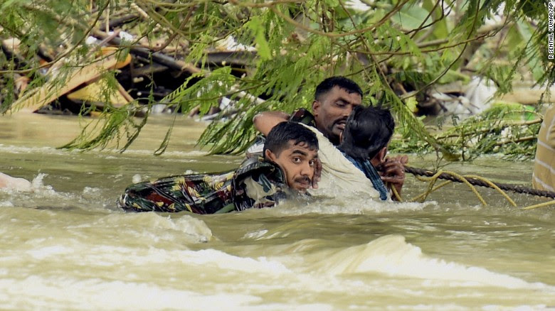 Indian army soldiers rescue a man from flood waters in Chennai, India, December 3.