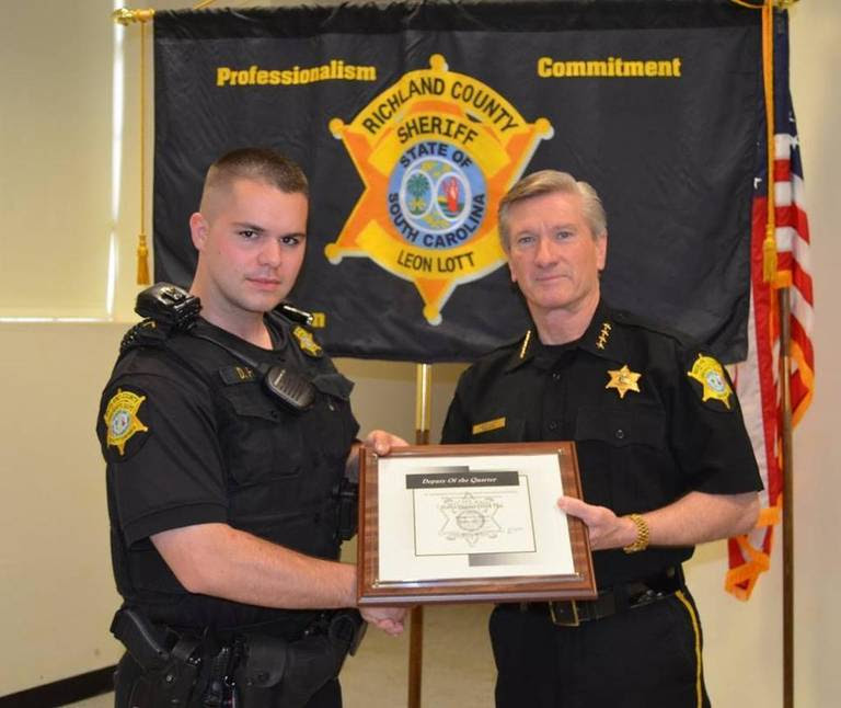 """Senior Deputy Derek Fish, left, fatally shot himself in his patrol car while on duty Friday. He was recognized with the Sheriff's Department's """"Deputy of the Quarter"""" award in April."""