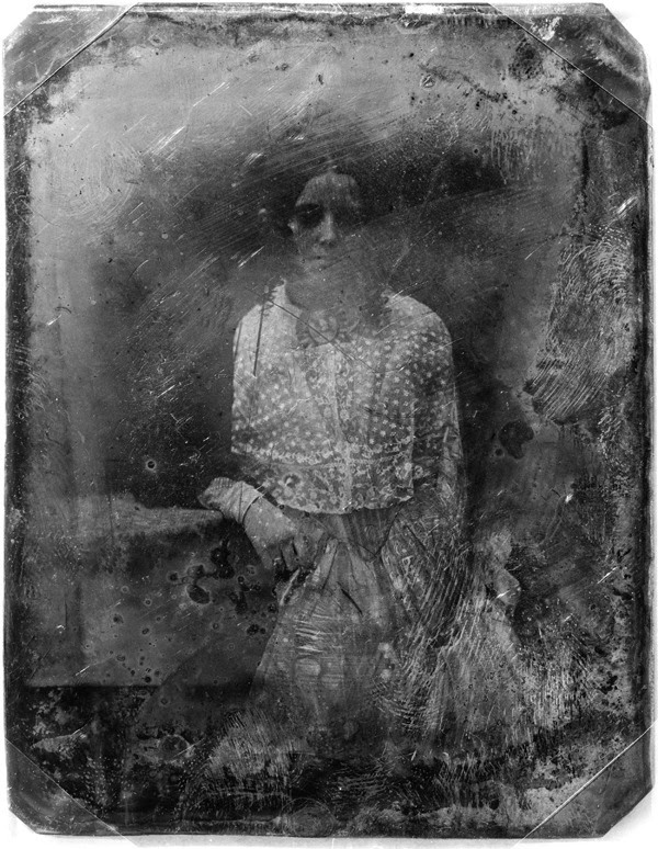 Unidentified woman, three-quarter length portrait, facing front, with arm resting on table, daguerreotype, produced by Mathew Brady's studio [between 1850 and 1860] via I'm not a person in this dream…