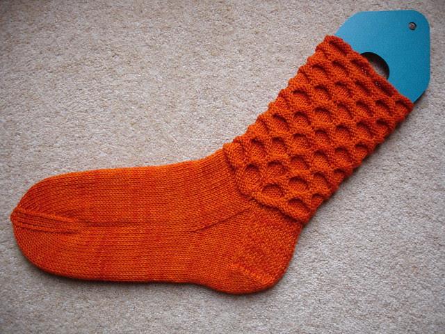 Extremely Orange Circle socks WIP