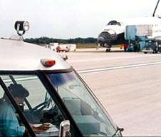 Nicole Stott with the convoy at the Shuttle Landing Facility.