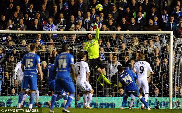Packs a punch: Chelsea goalkeeper Petr Cech stretches to repel a Birmingham cross