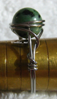 side view of wire wrapped ring with green stone (no name)
