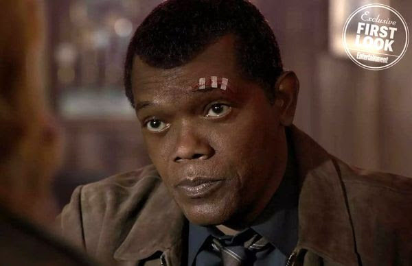 A young, two-eyed Nick Fury (Samuel L. Jackson) in CAPTAIN MARVEL.