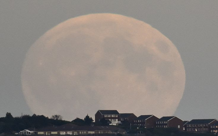 "A ""supermoon'' rises above Brighton in southern England"
