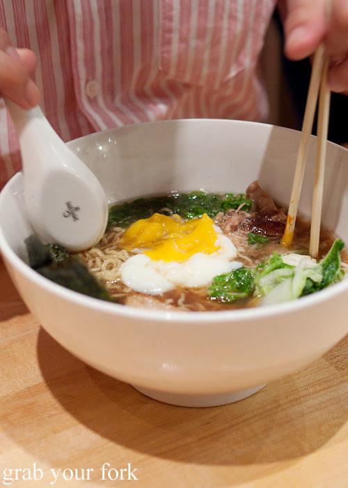 eating momofuku pork ramen noodles at momofuku noodle bar nyc new york david chang