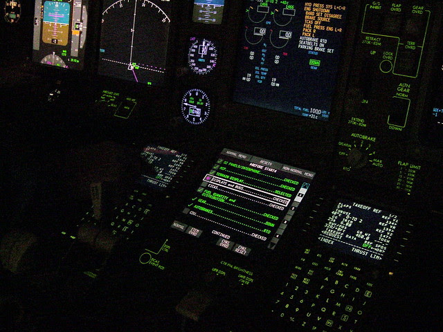 777 Simulator Cockpit.  Checklist diplayed.