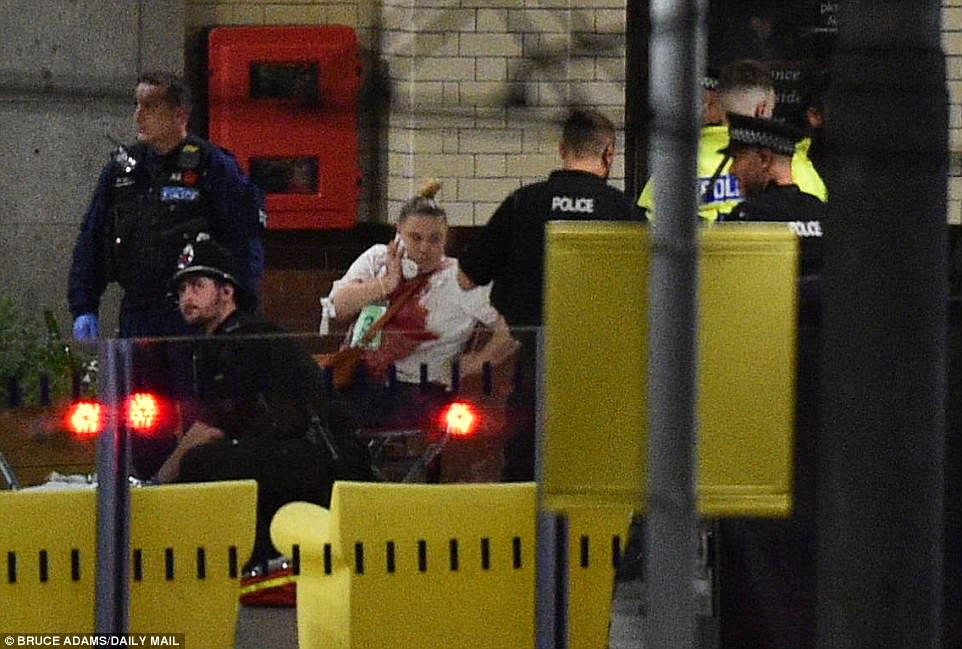 A woman spotted being helped by emergency services following the suspected terror attack in Manchester