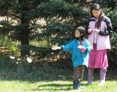 Girls Spreading Milkweed Seeds