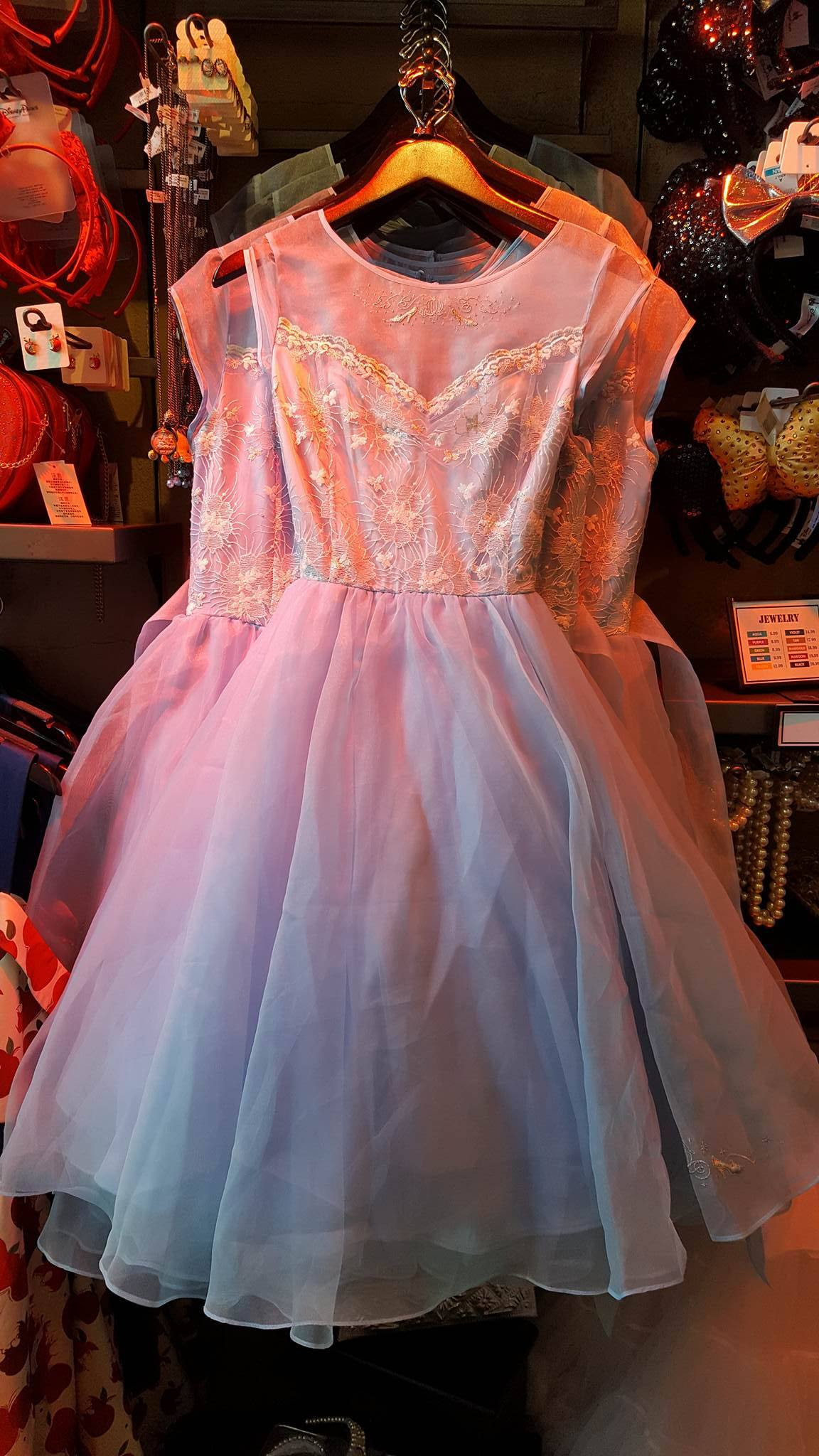 dresses are now restocked at the dress shop in disneyland