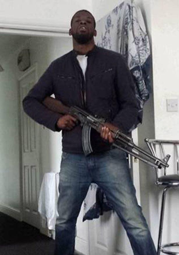 Aaron Murray holding an AK-47