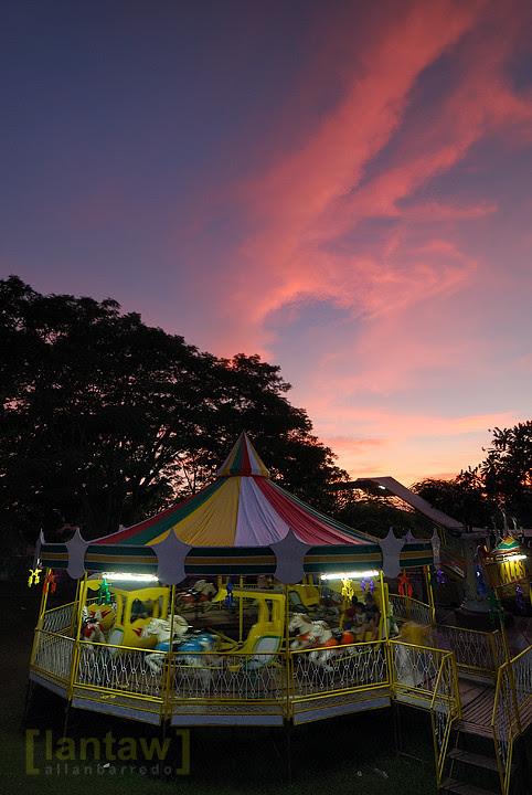 Merry go round at sunset