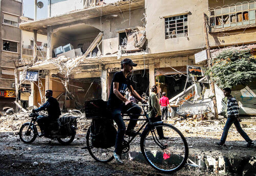 The population of the Syrian city of Douma — a rebel enclave — has dropped from 750,000 to about 250,000 since the start of the Syrian conflict. Photographer Saeed al-Batal (a pseudonym) has captured life in this city under siege. Here, a scene from Douma photographed on Oct. 23.