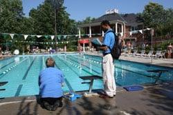 Two men evluating swimming pool