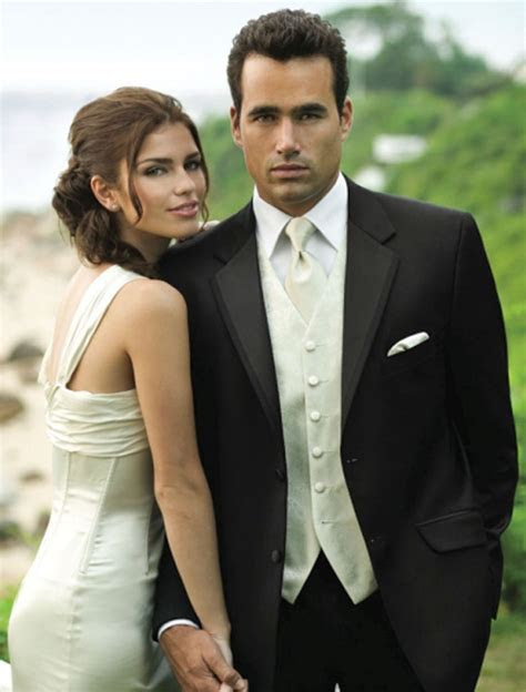 Tux for the groom? Black tux, white shirt, ivory vest and