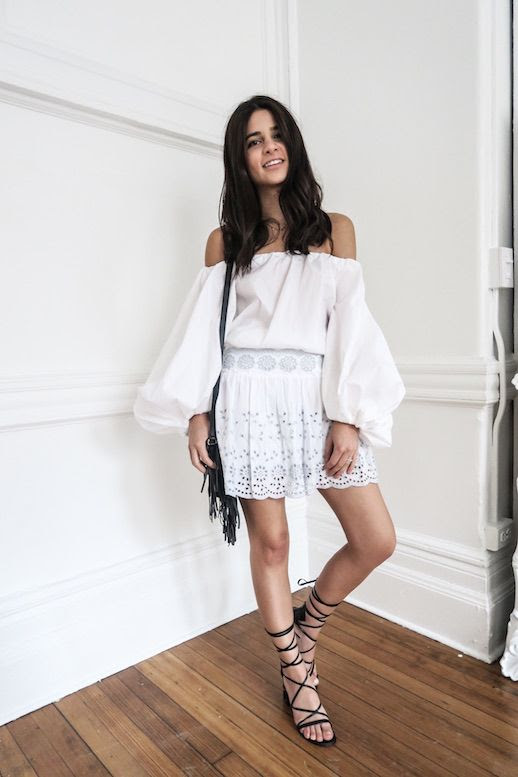 Le Fashion Blog Off Shoulder White Top White Eyelet Skirt Black Strappy Sandals Black Fringe Bag Via Haute Inhabit