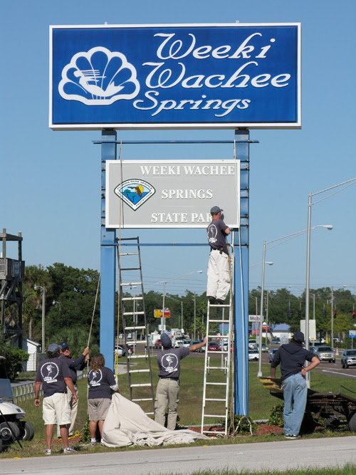 workers install new signs at Weeki Wachee Springs, Florida