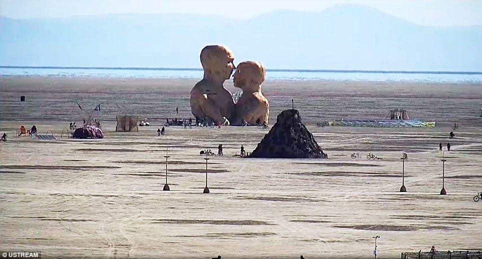 Tuesday morning: Tens of thousands were stranded in the desert at the gates of Burning Man after the enormous festival was postponed following rains that turned the playa into a quagmire