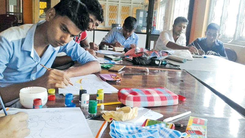 Students working on their art. Picture by Addalaichenai Central Corr.