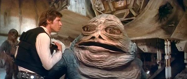Han Solo confers with Jabba the Hutt (whose computer-generated look was revamped for the 2004 DVD releases of the original trilogy) on Tatooine in the STAR WARS: SPECIAL EDITION.