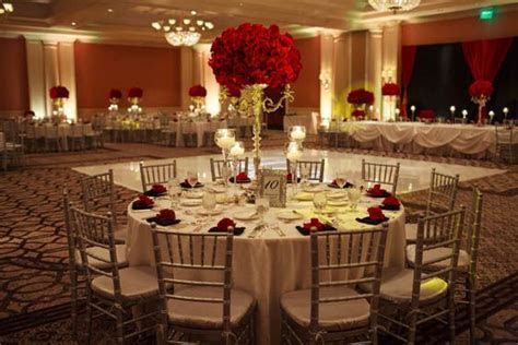 Elegant red roses reception at The Ballroom at the St