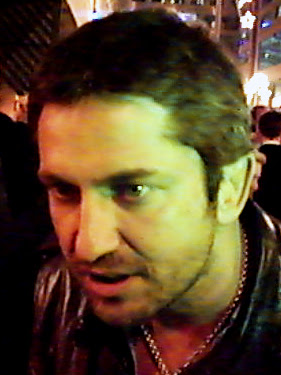 Gerard Butler while giving autographs at the B...