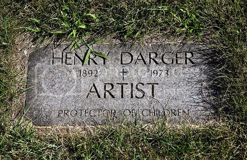 Picture of a flat gravestone with grass growing over it. It says: Henry Darger, 1892-1973, artist, protector of children.