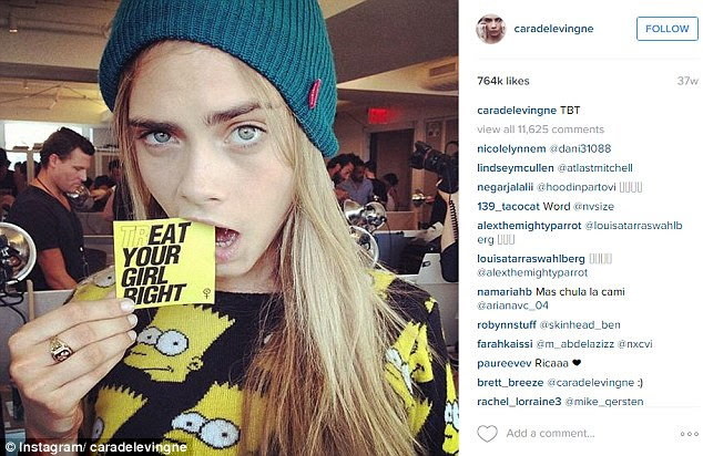 Popular pic: Cara Delevingne's silly picture of her biting a card which reads: 'TrEAT your girl right', landed the seventh spot at 764,000 likes