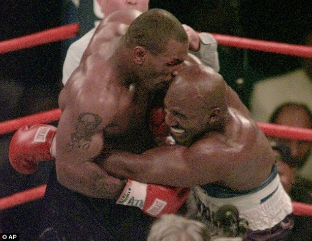 Tyson says Evander Holyfield was a serial head butter with ties to steroids (pictured biting Holyfield in the ring in June, 1997)