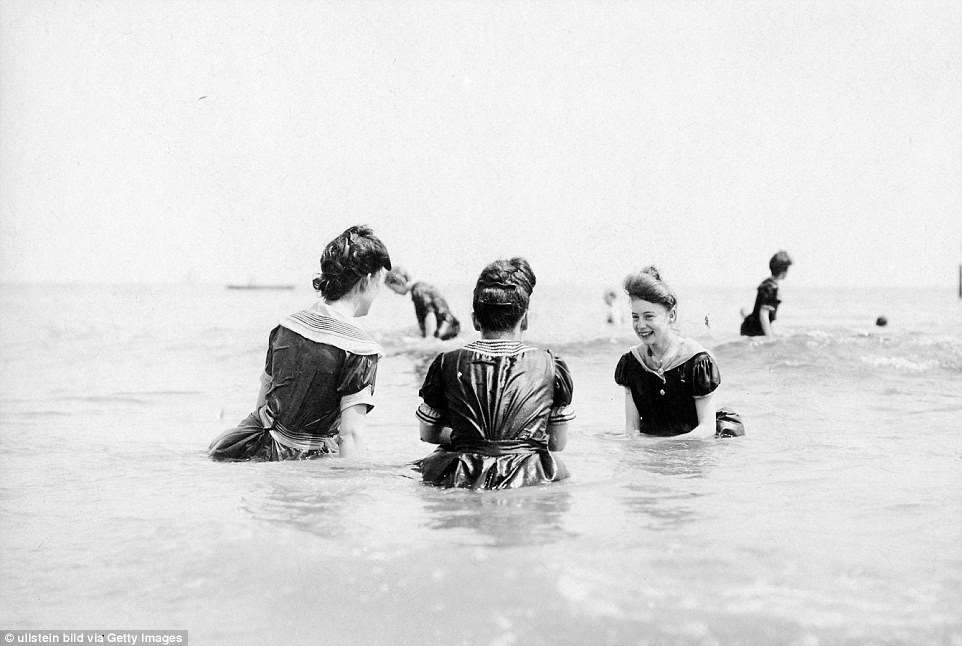 Forget tiny bikinis and swimming costumes, women would wade out into the sea wearing full length dresses in 1904