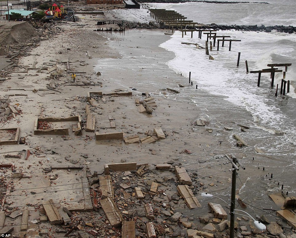 Stark: Foundations and pilings are all that remain of brick buildings and a boardwalk in Atlantic City, New Jersey
