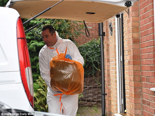 Forensics personnel were seen taking evidence out of the home where the attack took place and putting it into a van