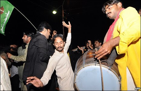 Supporters of former prime minister Nawaz Sharif dance in the streets of Gujrawala, Pakistan