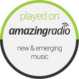 circular disc with gray border containing the text: played on amazingradio