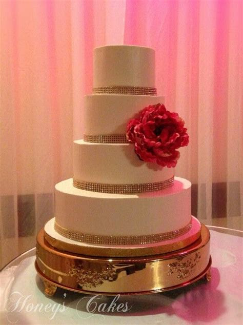 Simple yet elegant Ivory Buttercream wedding cake with