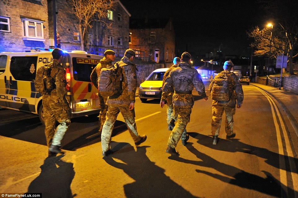 Soldiers: Homes either side of the bridge were being evacuated, with residents being taken to a rest centre at Tadcaster grammar school