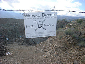 Danger sign at the entrance to an old mine in ...
