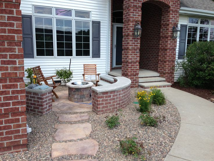 A sunrise landscape patio in WI needs extra heat to extend usability.  It may be the next rage in front porches in sub-divisions that have forgotten the street and their neighbors.  By Chad Cornette at Cantilever Studio