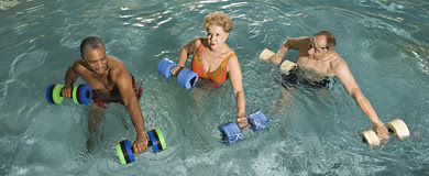 3 adults exercising in swimming pool