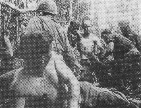 File:Wounded American soldiers being moved to aid station (Battle of Dak To, 1967).jpg